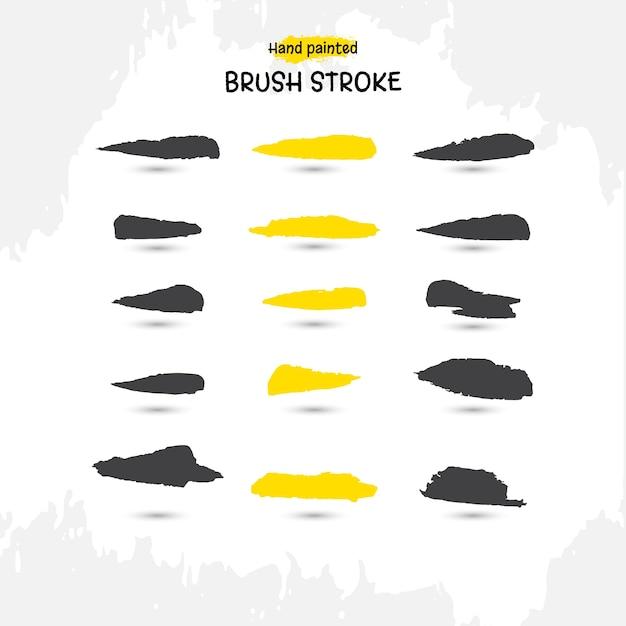 Handgemachte aquarell pinselstrich set schwarz und gelb Kostenlosen Vektoren