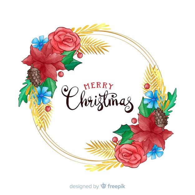 Handgezeichnete frohe weihnachten mit blumen Kostenlosen Vektoren