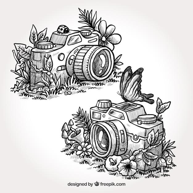 Handgezeichnete künstlerische kameras Kostenlosen Vektoren