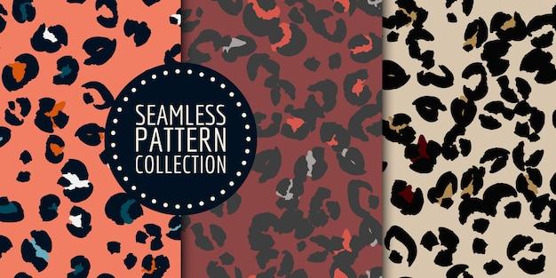 Handgezeichnete leopardenflecken nahtlose muster gesetzt Premium Vektoren