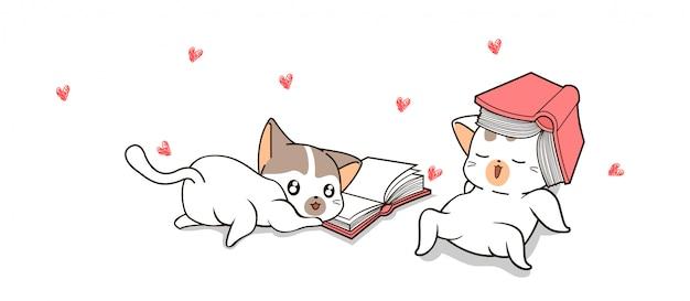 Handgezeichnete süße katzen lesen bücher Premium Vektoren