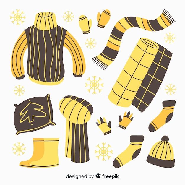 Handgezeichnete winterkleidung und essentials Kostenlosen Vektoren
