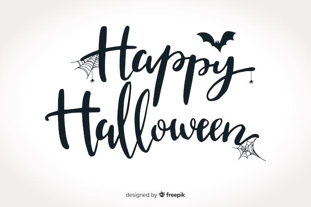 Happy halloween schriftzug mit fledermaus Kostenlosen Vektoren
