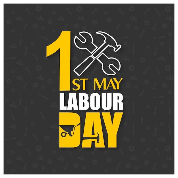 Happy labor day mit hammer und schraubenschlüssel auf einem schwarzen hintergrund Kostenlosen Vektoren
