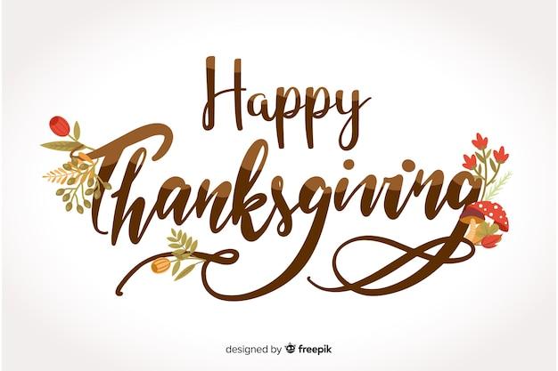 Happy thanksgiving schriftzug mit blumen Kostenlosen Vektoren