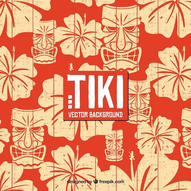 Hawaiian hintergrund mit blumen und tiki maske Premium Vektoren
