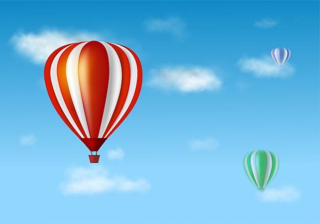 Heißluftballon und wolken am blauen himmel Premium Vektoren