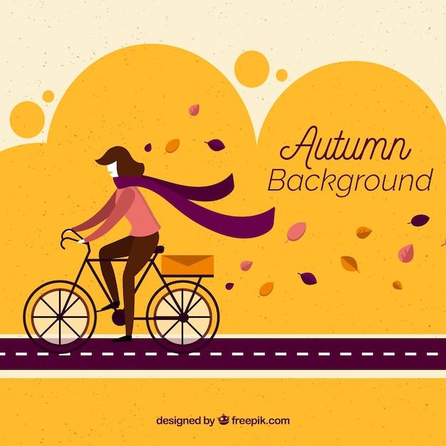 Herbst hintergrund mit fahrrad Kostenlosen Vektoren