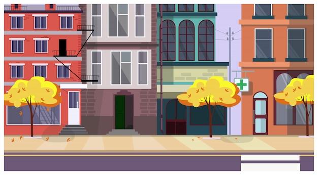 Herbststadtstraße mit bäumen und gebäuden im hintergrund Kostenlosen Vektoren