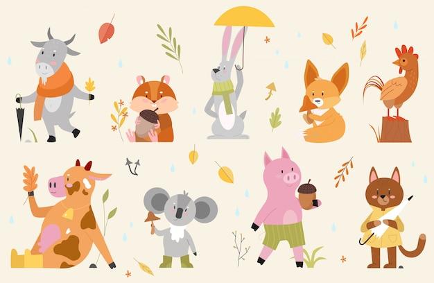 Herbsttiere illustrationssatz. hand gezeichnete herbstliche waldsammlung der karikaturhand mit niedlichen tierfiguren, die herbstsaison im wald genießen, lustiger kuhziegenhahnfuchshamsterschweinkatzenhase Premium Vektoren