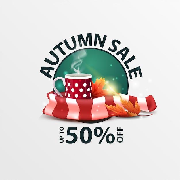 Herbstverkauf, runde rabattfahne mit becher heißem tee und warmem schal Premium Vektoren