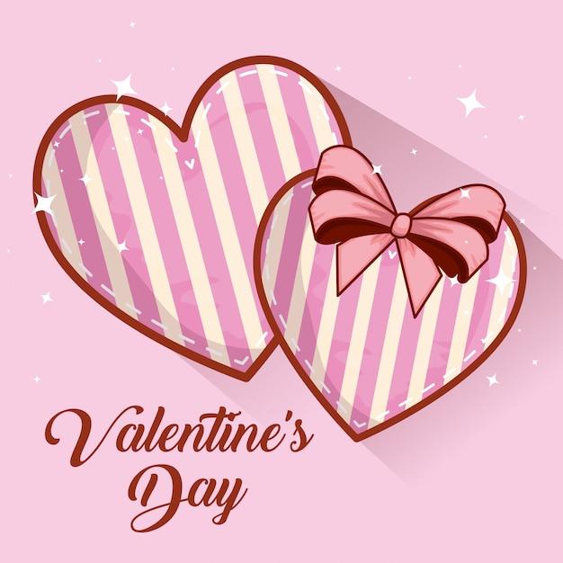 Herzen mit bandbogendekoration zum valentinsgrußtag Premium Vektoren