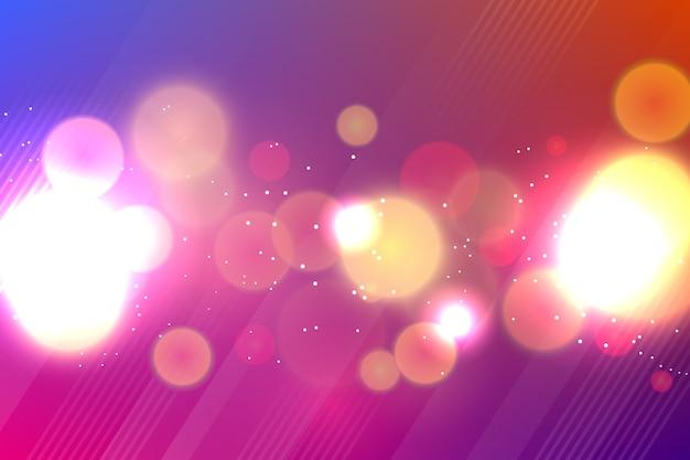 Hintergrund mit farbverlauf im bokeh-stil Kostenlosen Vektoren