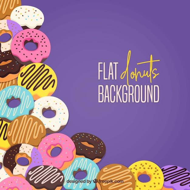 Hintergrund mit köstlichen donuts Kostenlosen Vektoren