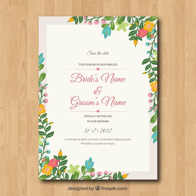 Hochzeitseinladung mit Blumenrahmen Kostenlose Vektoren