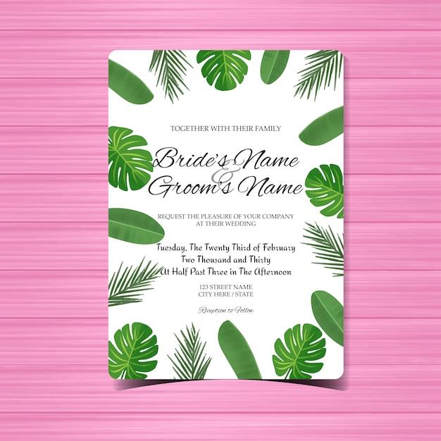 Hochzeitseinladungskarte mit herrlichen tropischen blättern Premium Vektoren