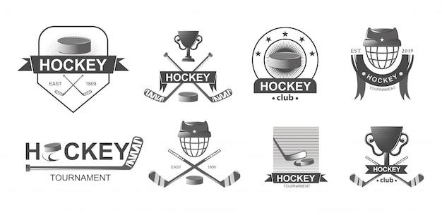 Hockey-logo und abzeichen Premium Vektoren