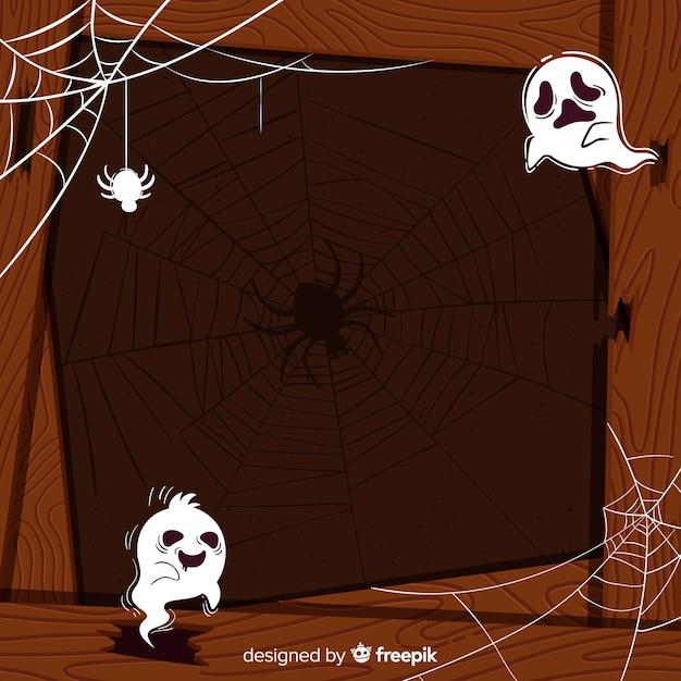 Hölzerner halloween-rahmen mit geistern Kostenlosen Vektoren
