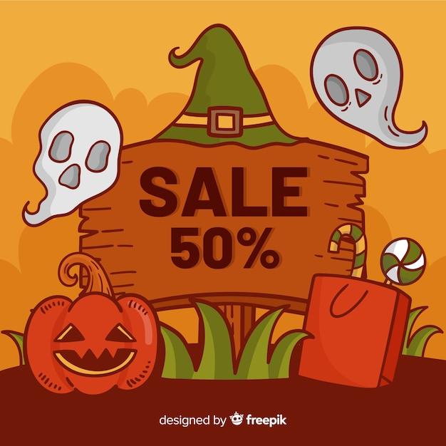 Hölzernes plakat des verkaufs für halloween-angebote Kostenlosen Vektoren
