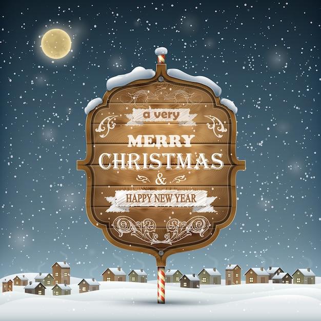 Hölzernes weihnachtsschild auf dem schnee. Premium Vektoren