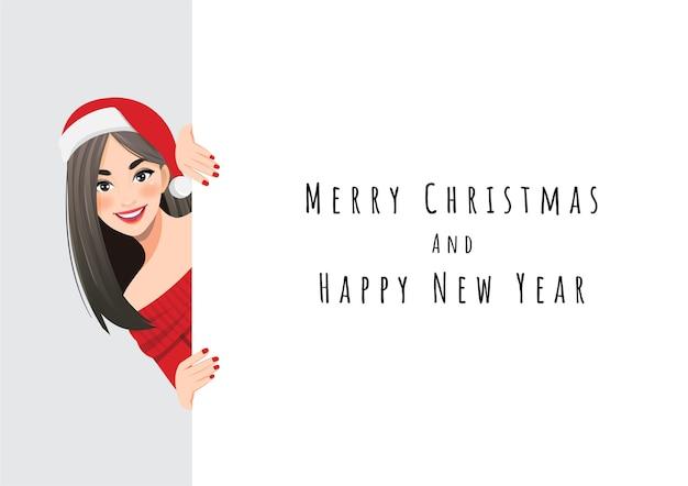 Hübsche frau im roten pulloverkleid und im weihnachtsmannhut, die hinter dem weißen fahnencharakter stehen Premium Vektoren