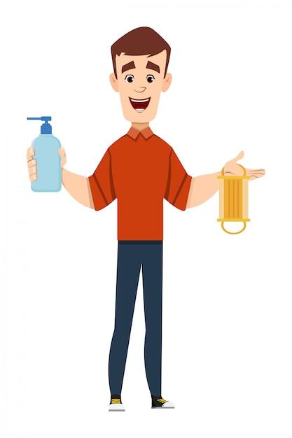 Hübscher mann, der desinfektionsgelflasche und gesichtsmaske hält und zeigt Premium Vektoren