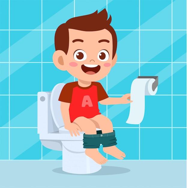 Illustration des glücklichen netten jungen sitzen auf der toilette Premium Vektoren