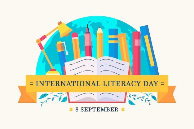 Internationaler alphabetisierungstag mit büchern und stiften Kostenlosen Vektoren