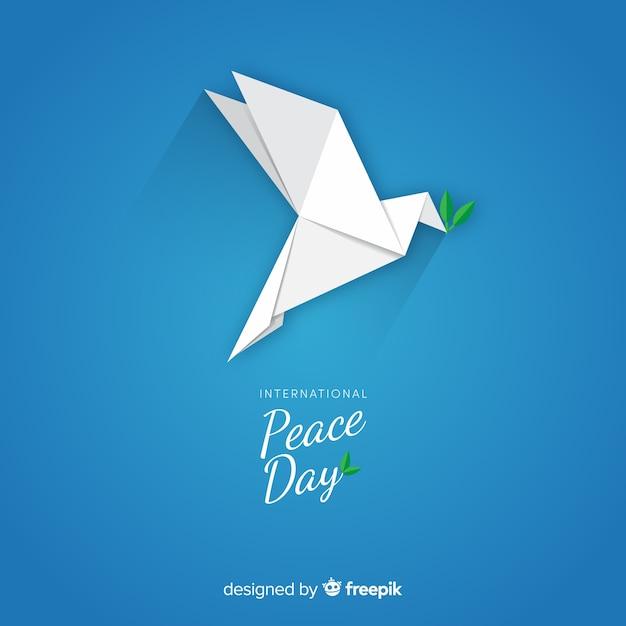 Internationaler friedenstag mit origami-taube Kostenlosen Vektoren