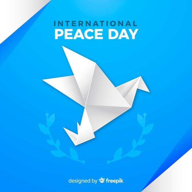 Internationaler friedenstag origami taube Kostenlosen Vektoren