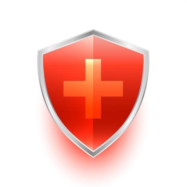 Isoliertes medizinisches schutzschildsymbol mit kreuz Kostenlosen Vektoren