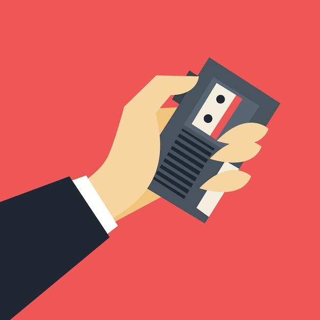 Journalistisches konzept. hand hält ein tonbandgerät Premium Vektoren