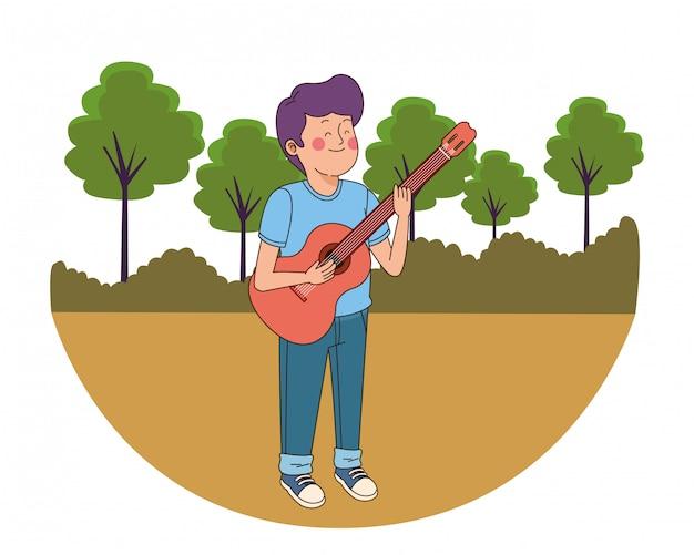 Jugendlichjunge, der die gitarre spielt Premium Vektoren