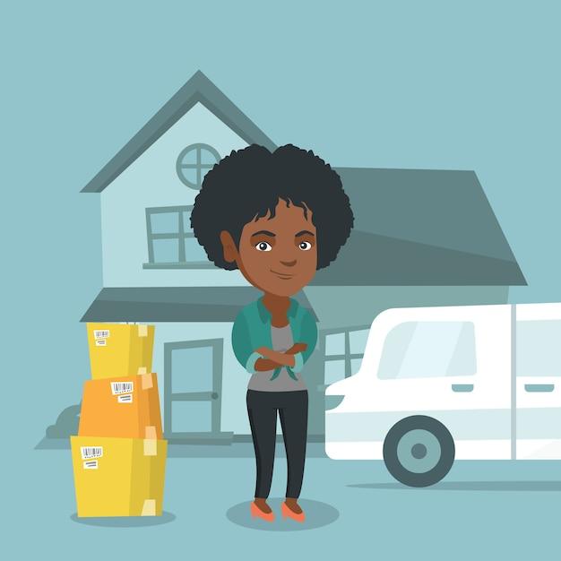 Junge afroamerikanerfrau, die auf ein neues haus umzieht Premium Vektoren