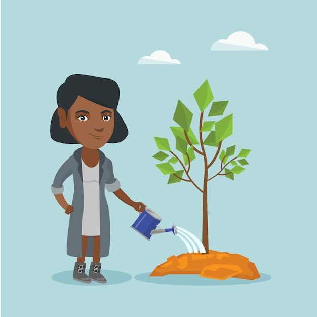 Junge afroamerikanerfrau, die einen baum wässert. Premium Vektoren
