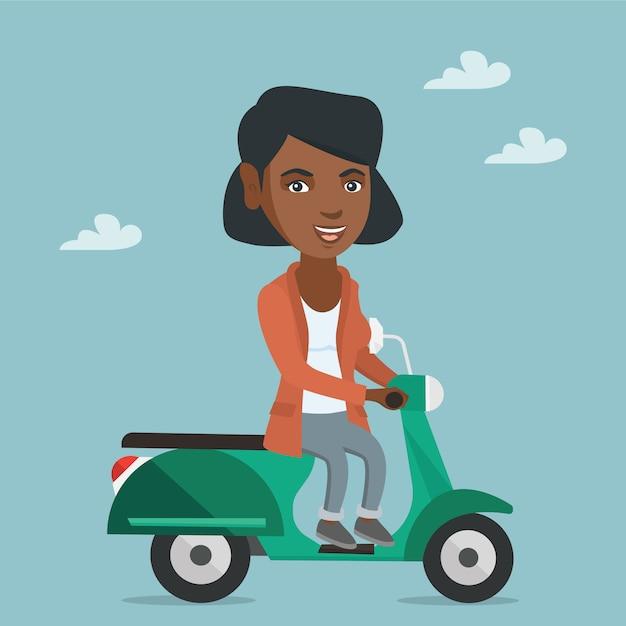 Junge afroamerikanerfrau, die einen roller reitet. Premium Vektoren