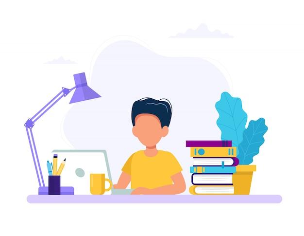 Junge, der mit computer und büchern studiert. Premium Vektoren