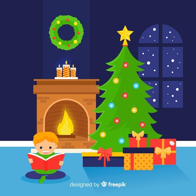Junge, der weihnachtsabbildung liest Kostenlosen Vektoren