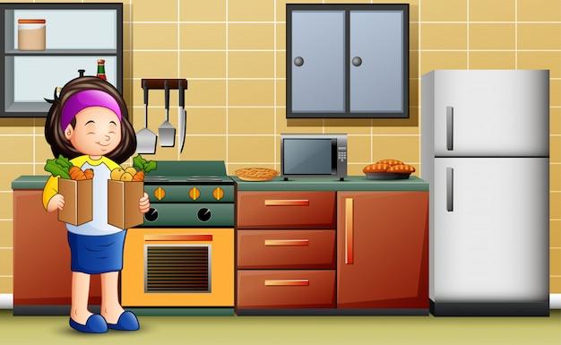 Junge frau, die zwei tasche gemüse in der küche hält Premium Vektoren