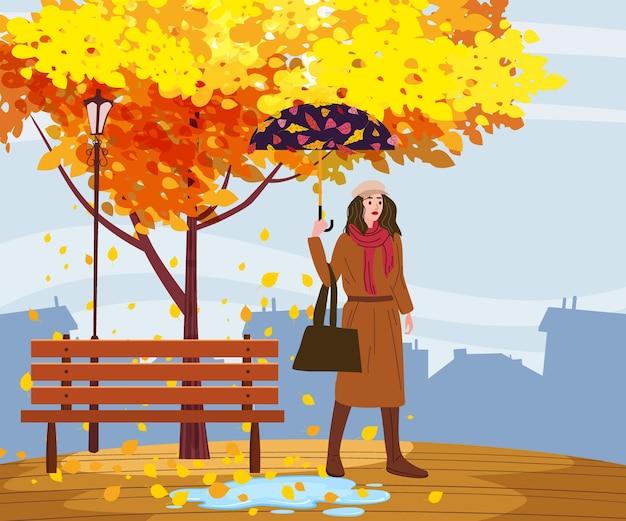 Junge frau in der herbstparkstadt mit regenschirm, trendige kleidung straße modischen stil outwear weiblich Premium Vektoren