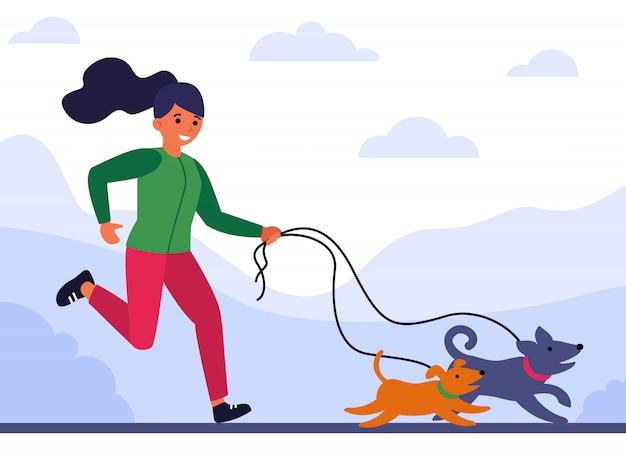 Junge frau läuft und geht hunde Kostenlosen Vektoren
