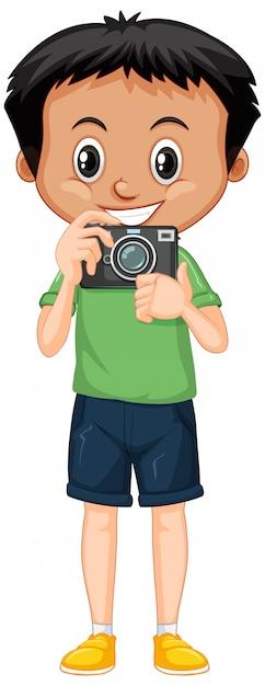 Junge im grünen hemd mit digitalkamera auf weiß Kostenlosen Vektoren