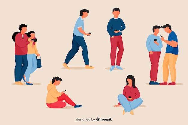Junge leute, die ihren smartphonesatz halten Kostenlosen Vektoren