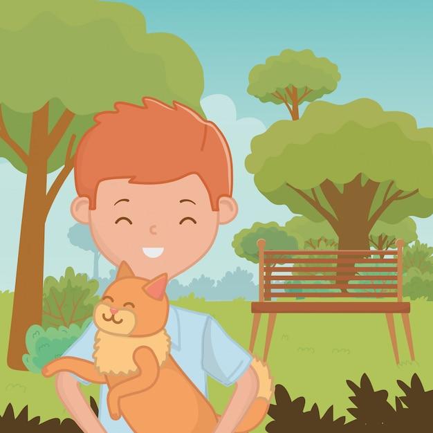 Junge mit katzenkarikaturdesign Kostenlosen Vektoren
