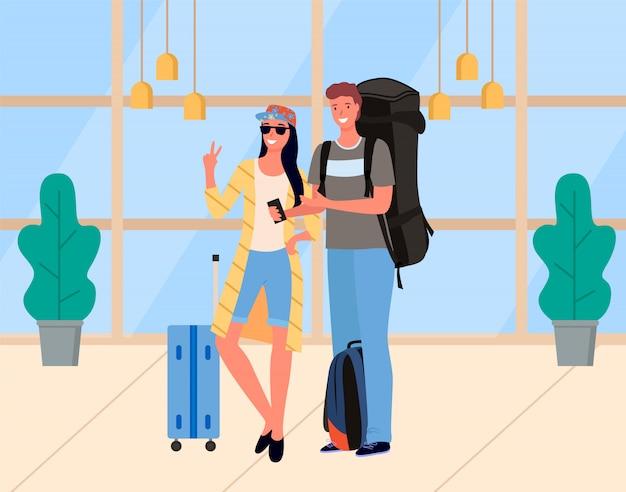 Junge paare von touristen mit gepäck-vektor Premium Vektoren
