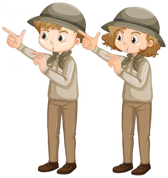 Junge und mädchen in der pfadfinderuniform, die finger zeigt Kostenlosen Vektoren