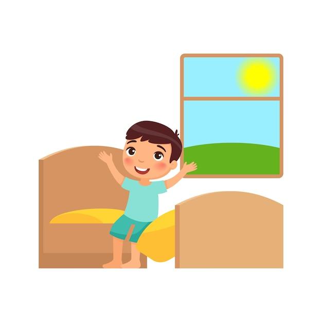Junge wacht auf und setzt sich auf das bett. illustration des täglichen regimes Premium Vektoren