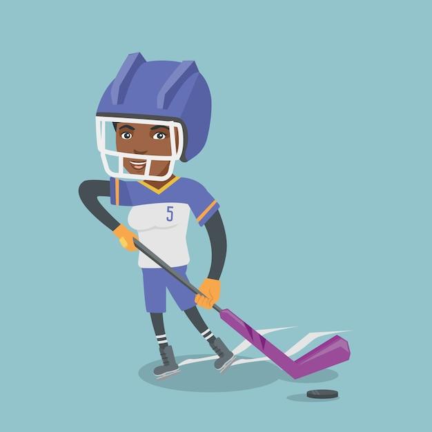 Junger afrikanischer eishockeyspieler mit einem stock. Premium Vektoren