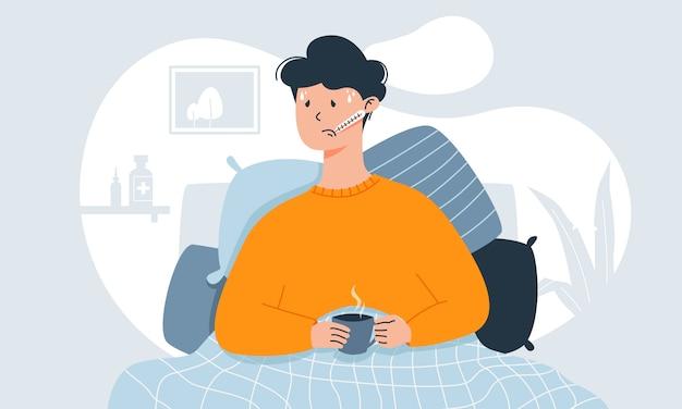 Junger mann mit erkältungssymptomen wie fieber, kopfschmerzen und halsschmerzen misst die temperatur in seinem bett und hält eine tasse tee. Premium Vektoren