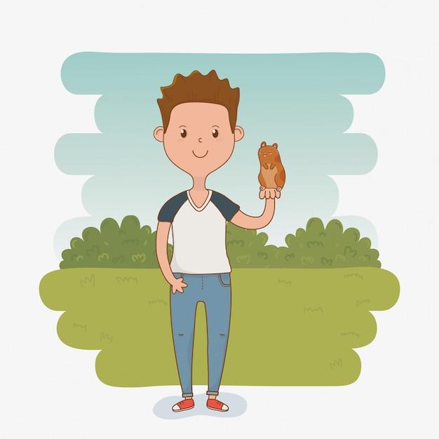 Junger mann mit nettem meerschweinchenmaskottchen Premium Vektoren